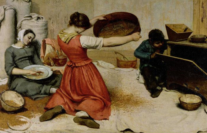 麦をふるう女